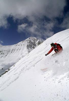 A Powder Skier Descends Slope In Front Art Print by Gordon Wiltsie