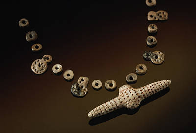 Ivory Carving Photograph - A Prehistoric Necklace Is Made by Sisse Brimberg