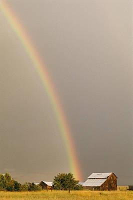 A Rainbow Arches Across The Sky Onto Art Print