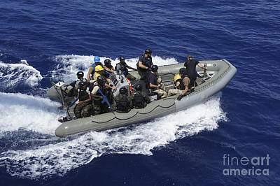 Inflatable Photograph - A Rigid-hull Inflatable Boat Carrying by Stocktrek Images