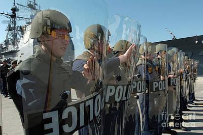 A Riot Control Team Braces Art Print by Stocktrek Images