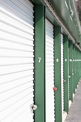 A Row Of Locked Storage Units At A Self Storage Facility Print by Frederick Bass
