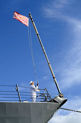 A Sailor Lowers The U.s. Navy Jack Art Print by Stocktrek Images