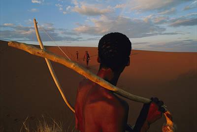 Bushman Photograph - A San Tribesman With His Bow And Arrow by Chris Johns