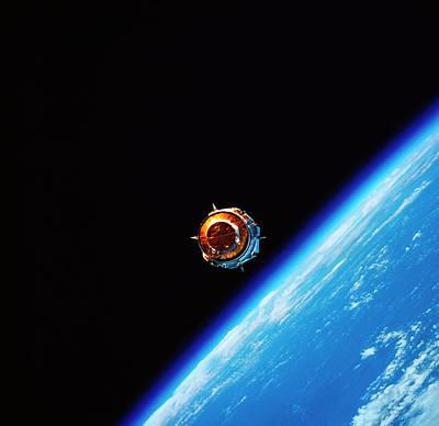 A Satellite In Orbit Above Earth Art Print by Stockbyte