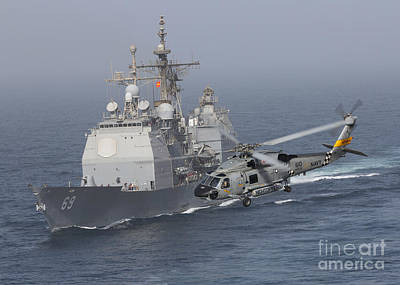 A Sh-60j Seahawk Flys By Uss Vicksburg Art Print by Gert Kromhout