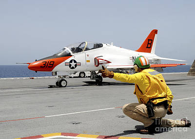 Naval Aircraft Photograph - A Shooter Signlas The Launch Of A T-45a by Stocktrek Images