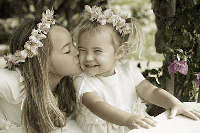Little Sister Photograph - A Sister's Kiss by Sri Maiava Rusden - Printscapes