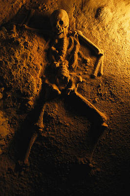 Human Sacrifice Photograph - A Skeleton From A Human Sacrifice Turns by Stephen Alvarez