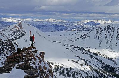 Beartooth Mountain Range Photograph - A Skier Overlooks Absaroka Range by Gordon Wiltsie
