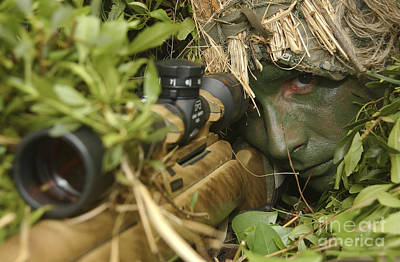 A Sniper Dressed In A Ghillie Suit Art Print by Stocktrek Images