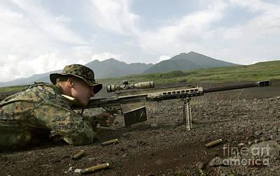 A Sniper Fires A M82a3 .50-caliber Art Print by Stocktrek Images