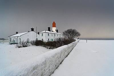 A Snow Covered Fence With A Lighthouse Art Print by John Short