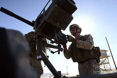 A Soldier Fires 40mm Rounds Art Print by Stocktrek Images