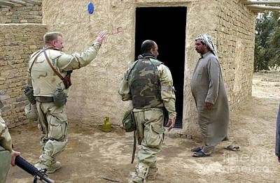 A Soldier Greets A Homeowner In Central Art Print by Stocktrek Images