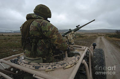 Pink Panther Photograph - A Soldier Mans A .50 Caliber Machine by Andrew Chittock