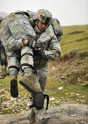A Soldier Transports A Fellow Wounded Art Print by Stocktrek Images