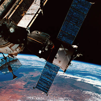 Space Ships Photograph - A Space Station Orbiting Above The Earth by Stockbyte
