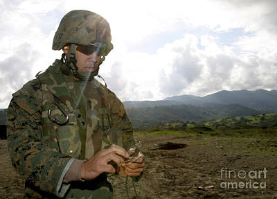 Fused Photograph - A Squad Leader Prepares A Time Fuse by Stocktrek Images