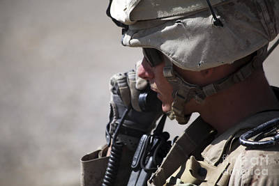 Talking On The Phone Photograph - A Squad Leader Puts His Marines by Stocktrek Images