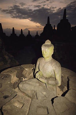 Religious Characters And Scenes Photograph - A Statue Of Buddha,  Borobudur, Java by Paul Chesley