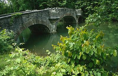 Cooperstown Photograph - A Stone Bridge Crosses The Headwaters by Raymond Gehman