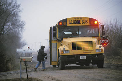 A Student Boards A School Bus Art Print