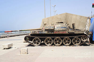 A T-55 Tank On The Seafront Art Print by Andrew Chittock