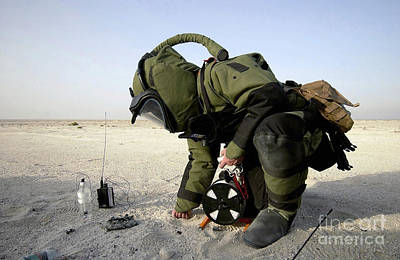 Improvised Explosive Device Photograph - A Technician Dressed In A Eod-8 by Stocktrek Images
