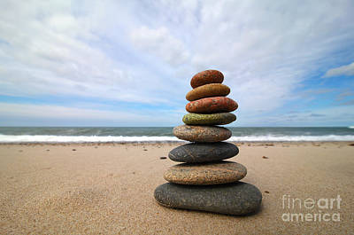 A Tower Of Stones On The Beach Art Print by Holger Ostwald