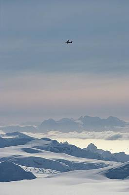 Calley Photograph - A Twin Otter Flies Over Calley Glacier by Gordon Wiltsie