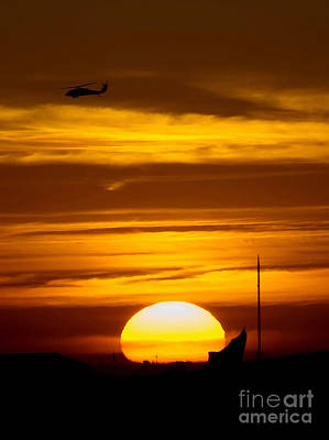 Night Hawk Wall Art - Photograph - A Uh-60 Black Hawk Helicopter Flies by Stocktrek Images