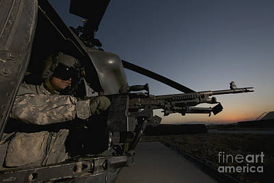 Obscured Face Photograph - A Uh-60l Blackhawk Door Gunner Mans by Terry Moore