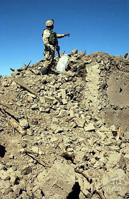 Photograph - A U.s. Army Soldier Examines The Rubble by Stocktrek Images