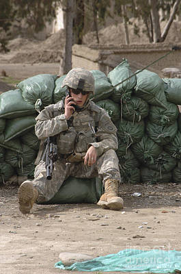 Photograph - A U.s. Army Soldier Talks On A Radio by Stocktrek Images