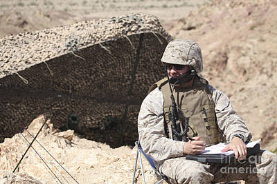 Talking On The Phone Photograph - A U.s. Marine Communicates With Close by Stocktrek Images