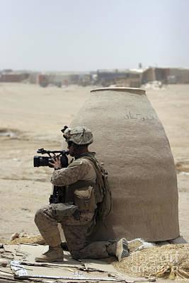 Videographer Photograph - A U.s. Marine Corps Combat Videographer by Stocktrek Images