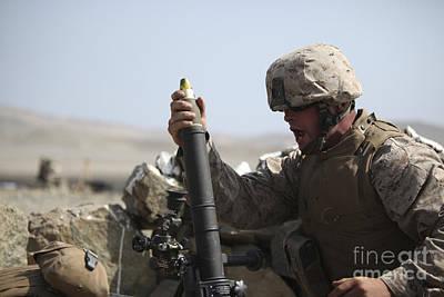 A U.s. Marine Loads A Mortar Art Print by Stocktrek Images