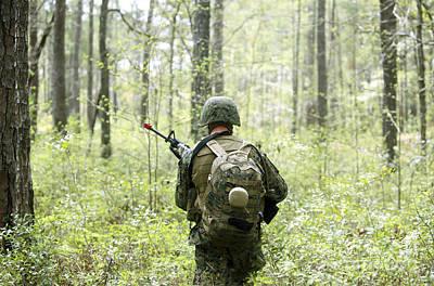 A U.s. Marine Patrols Through A Forest Art Print