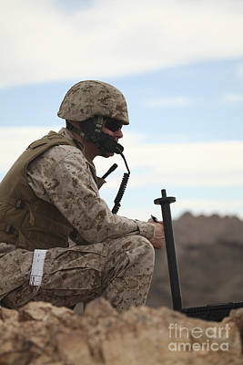 Talking On The Phone Photograph - A U.s. Marine Uses A Field Phone by Stocktrek Images
