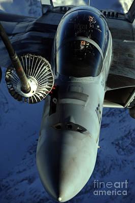 A U.s. Navy F-18 Hornet Is Refueled Art Print by Stocktrek Images