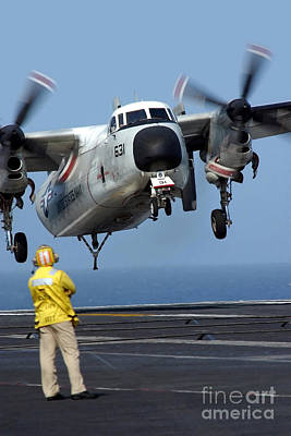 A U.s. Navy Officer Observes A C-2a Art Print by Stocktrek Images