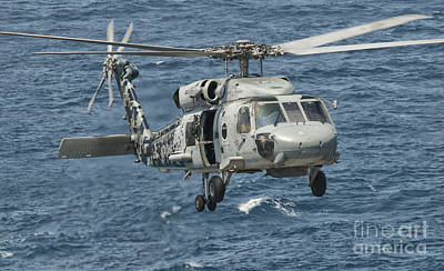 A Us Navy Sh-60f Seahawk Flying Art Print by Giovanni Colla