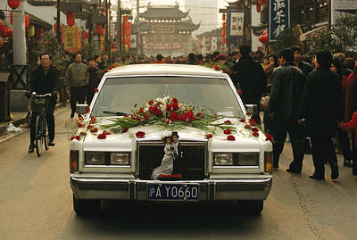 A Wedding Limousine With Flowers Rolls Print by Justin Guariglia