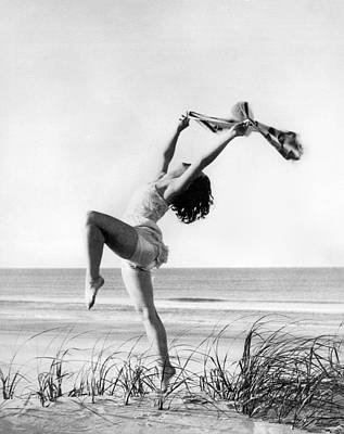 Solo Dancer Photograph - A Woman Dancing On The Shore by Underwood Archives