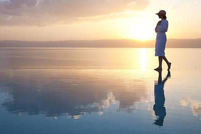 A Woman Enjoys The Warm Sun On The Edge Art Print by Taylor S. Kennedy