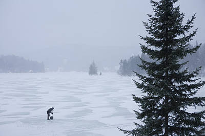 A Woman Shovels A Rink On A Lake Art Print by Taylor S. Kennedy