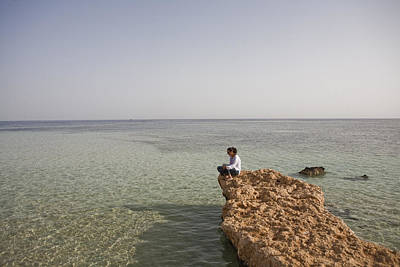 Aqaba Photograph - A Woman Sits On The Sinai Peninsula by Taylor S. Kennedy