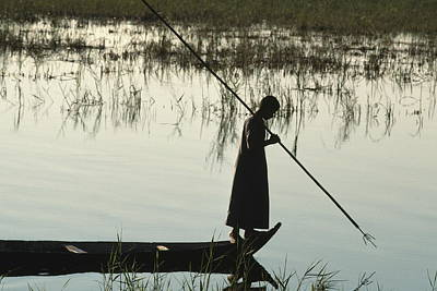 A Woman Stands At The End Of A Rowboat Art Print