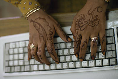 High Technology Devices Photograph - A Womans Hennaed Hands On A Computer by Lynn Abercrombie